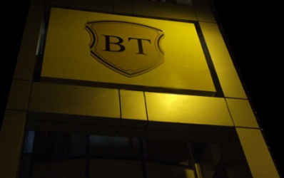 Provizioanele taie dramatic profitul trimestrial al Bancii Transilvania
